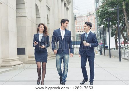 Group of business people walking at street