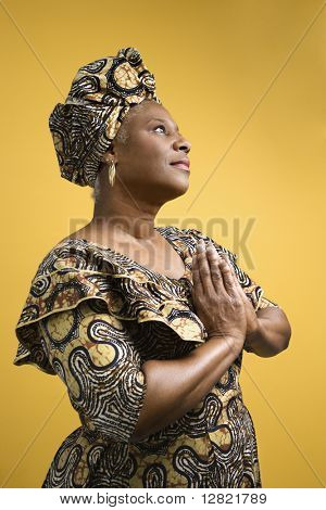 African American mature adult female dressed in African costume.