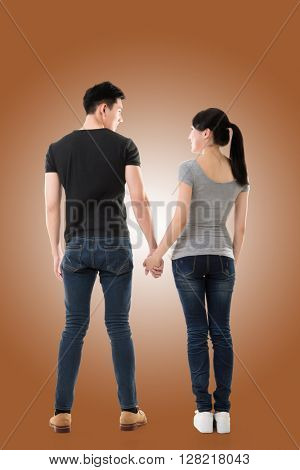 rear view of Asian young couple, full length isolated