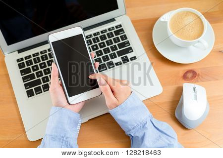Woman using cellphone on working desk