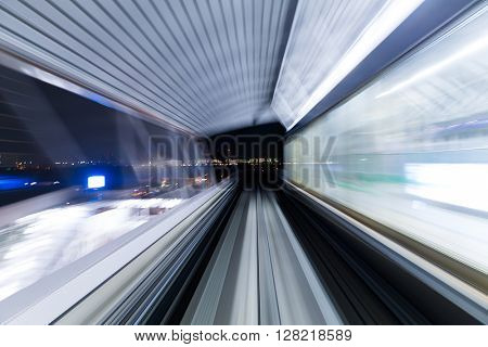 Motion blur of a city and tunnel