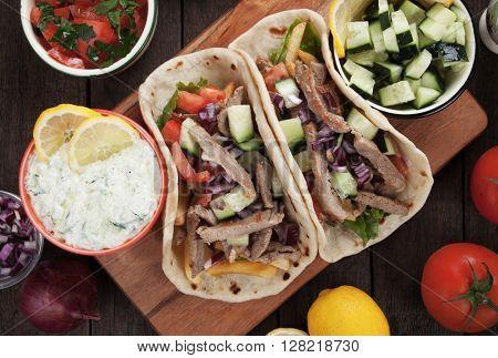 Greek gyros pita wrapped sandwich similar to turkish doner kebab