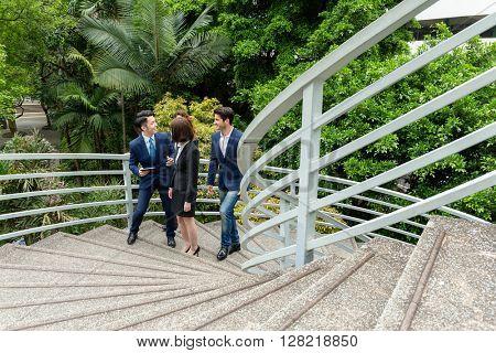 Business people walking upstairs