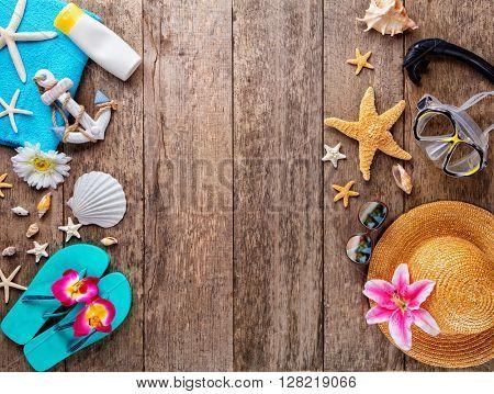 Beach accessories on wooden background