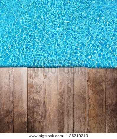 Old wooden planks over swimming pool