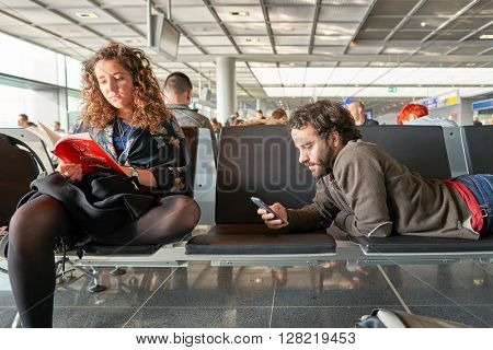 FRANKFURT, GERMANY - MARCH 13, 2016: passengers at Frankfurt Airport. Frankfurt Airport is a major international airport located in Frankfurt and the major hub for Lufthansa