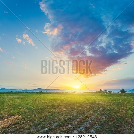 Magnificent landscape of meadow on background of beautiful sunset sky with clouds. Exploring Armenia