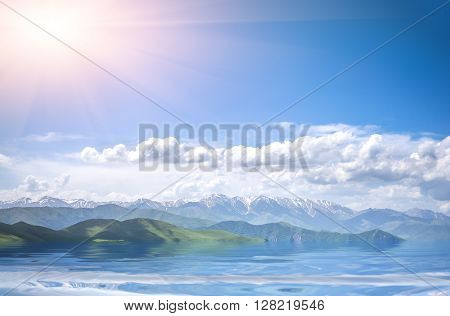 Beautiful view of mountains with sunny sea and cloudy blue sky