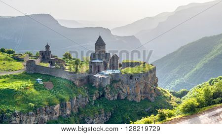 Ancient monastery in setting sun. Tatev. Armenia