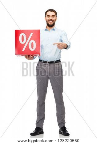 people, sale, shopping, discount and holidays concept - smiling man holding and pointing finger to red percentage sign