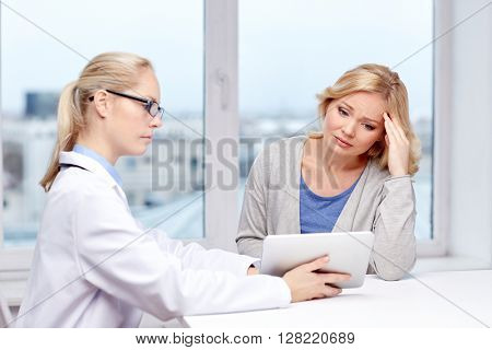 medicine, health care and people concept - doctor with tablet pc computer and unhappy ill woman meeting at hospital