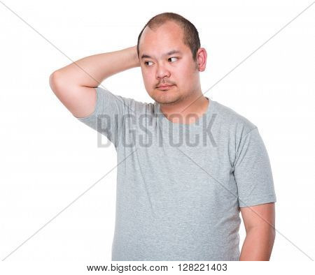 Asian man feeling itching his head