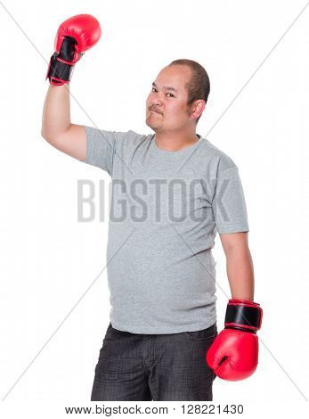 Old man raising up his arm with boxing gloves