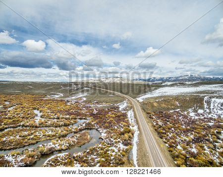 aerial view of meandering Grizzly Creek in Colorado's North Park, early spring scenery with some snow