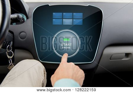 transport, driving, technology and people concept - close up of male hand using starter application on car computer