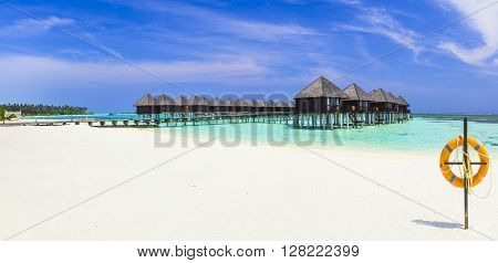 luxury holidays in Maldives island, panoramic view with water bungalows