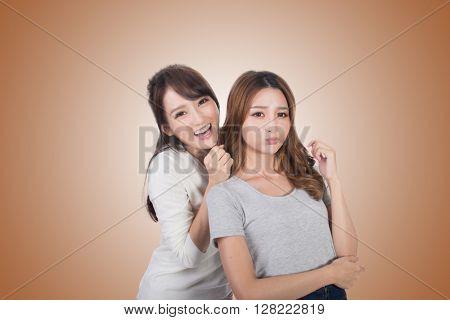 Asian woman with her friend, studio shot portrait.