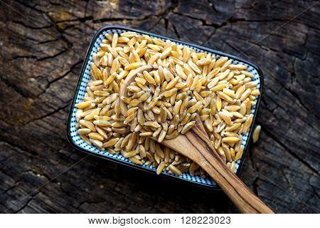 Organic Kamut Grain On Wooden Background