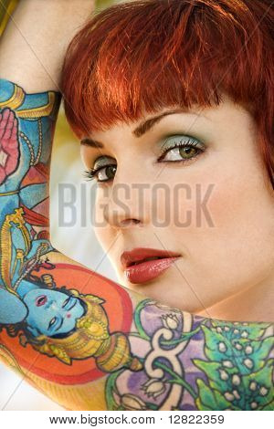 Close up portrait of attractive tattooed Caucasian woman in Maui, Hawaii, USA.