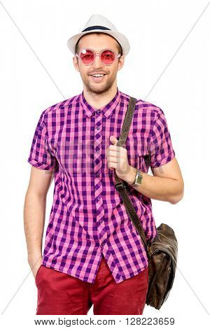 Happy young man in stylish bright clothes having fun. Summer fashion.