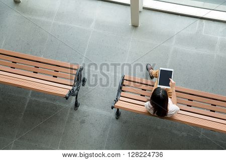 Top view of woman using digital tablet