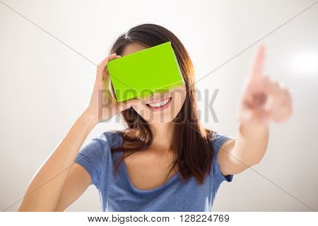 Woman wearing with VR device and finger pointing on air