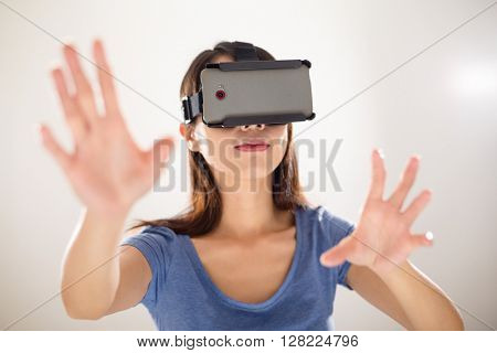 Woman looking though VR headset