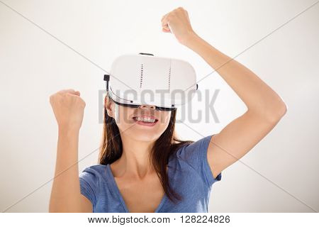 Excited woman looking though virtual reality headset