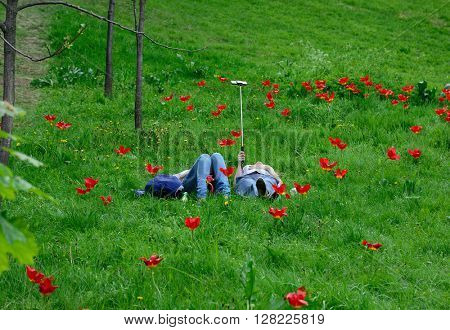 couple makes the selfie lying on flower field