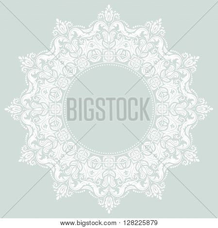 Oriental vector pattern with arabesques and floral elements. Traditional classic pattern. Light blue and white pattern. Fine round pattern. Light round pattern