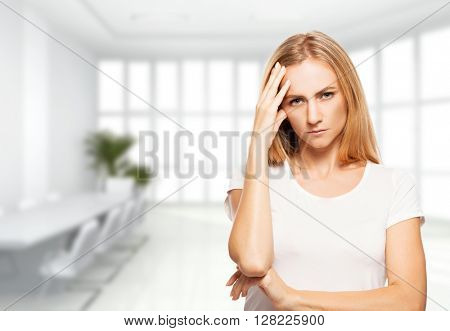 Sad woman in office building. Fired unemployed person