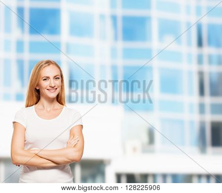 Happy businesswoman on the background of glass office building. Young smiling female outdoors