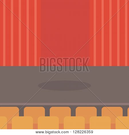 Theater stage with curtains, seats and spotlight.