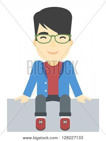 Smiling man sitting.