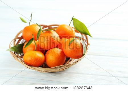 Ripe Mandarin On A Blue Wooden Table