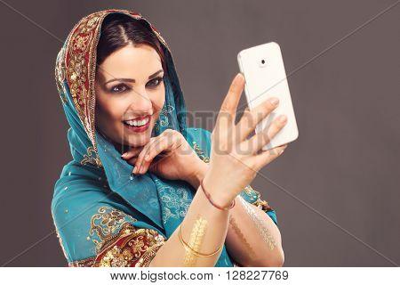 Portrait of oriental woman using smartphone