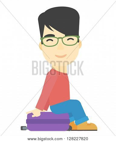 Man sitting on his suitcase.