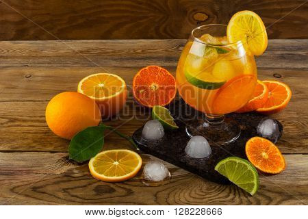 Citrus drink on wooden table. Fruit lemonade. Summer drink. Citrus lemonade. Fruit cocktail. Fruit drink