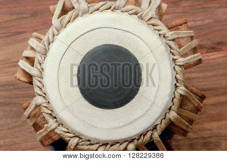 a traditional tabla drum on wooden surface seen from above