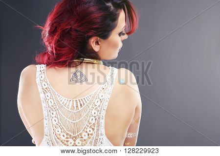 Back of beautiful mysterious oriental woman