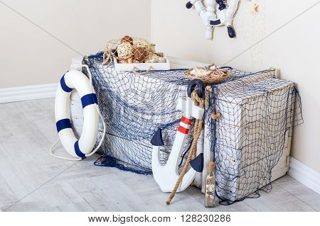 Marine elements of the interior: box net anchor and life preserver