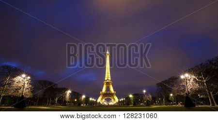 PARIS, FRANCE - MARCH 28, 2016: Beautiful view of illuminated Eiffel tower at dusk, Paris, France