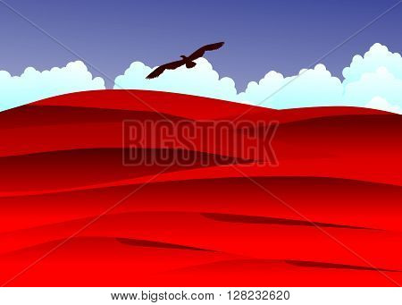 desert. Red dunes in the desert against blue clouds and the sky