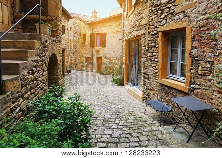 Side street of ancient French towns: Beaujolais village. Toned image