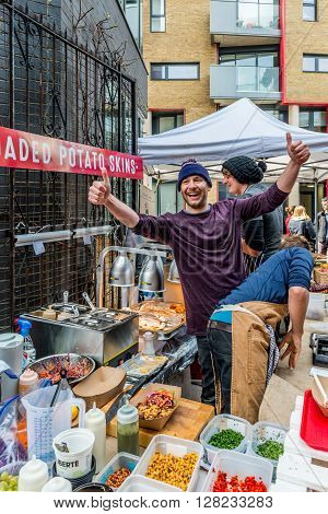 London United Kingdom - April 30 2016: Maltby Street Market in Bermondsey (located in railway arches SE1 Rope Walk). Great artisan street food stalls and bars. Loaded potatoes skins stall
