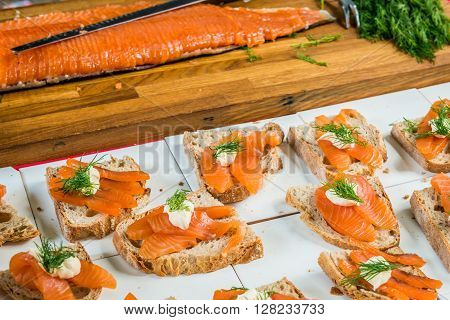 London United Kingdom - April 30 2016: Maltby Street Market in Bermondsey (located in railway arches SE1 Rope Walk). Great artisan street food stalls and bars. Salmon open sandwiches with dill on rye bread