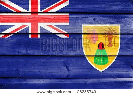 Flag Of Turks And Caicos Islands, Painted On Old Wood Plank Background