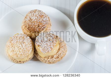 Top view of shu pastries with coffee