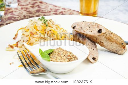 sausage and sauerkraut on a table in a restaurant