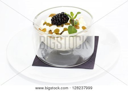 cottage cheese with sour cream and raisins on a white background